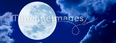 Full Moon Night Sky. A large full moon in a cloudy sky