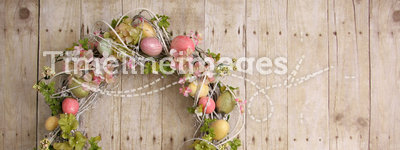 Easter egg wreath. On a wooden background. Also available in vertical