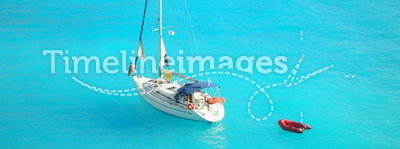 Yacht in light blue ionian sea