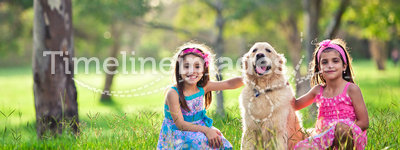 Beautiful little girls and golden retriever