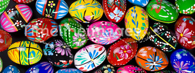 Painted Easter eggs. Painted eggs are decorated by various techniques before Easter.The imitation of painted eggs are made of wood (on the picture),covered by