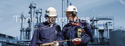 Engineers with oil and gas refinery