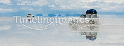 Jeep in the salt lake salar de uyuni