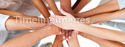 Business people-hands overlapping to show teamwork