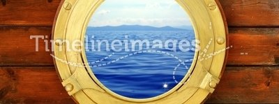 Boat closed porthole with vacation seascape view