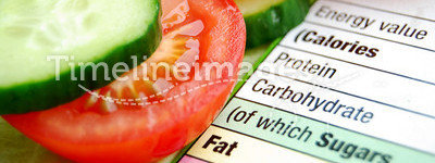 Healthy diet. Nutrition calculator and vegetables symbolising a healthy diet
