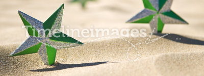 Christmas stars on beach