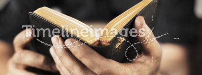 Bible. Dirty hands holding an old bible. Very short depth-of-field