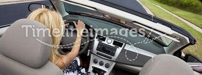 Beautiful Young Woman Driving Convertible Car