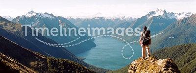 Kepler track, New Zealand. A male trekker admiring a Glacier carved valley, Kepler trek, New Zealand