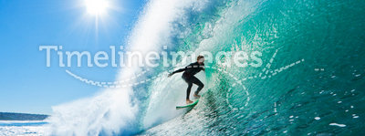 Surfer on Perfect Wave Getting Barreled. Surfer on Perfect Blue Wave in the Barrel, Epic Tube