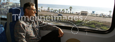 Senior Man Traveling on Train