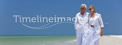 Happy Senior Couple Walking on A Tropical Beach