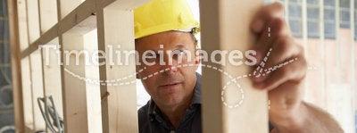 Construction Worker Building Timber Frame