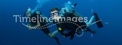Couple scuba diving