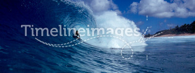 Bodyboarder Surfing a Big Blue Tube Wave