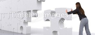 Business teamwork - businesswoman building a puzzle