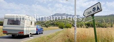 Car with caravan at road