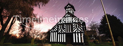 Church at night with star trails