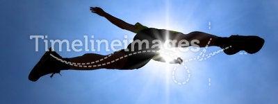 The Silhouette of runner acrossing sky