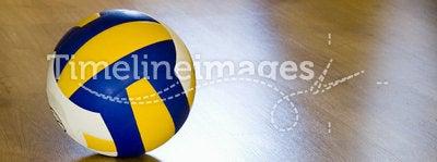 Volleyball on hardwood floor. A professional volleyball lying on a hardwood floor