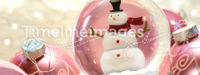 Snow globe with pink  balls
