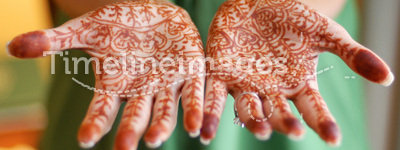 Henna painted hands. Traditional indial henna painting of bride's hands at a wedding