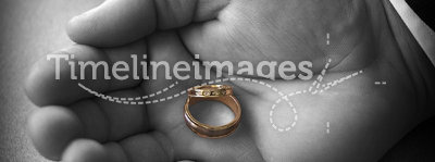 Wedding Rings I. A pair of new wedding rings held in the Best Man's hand