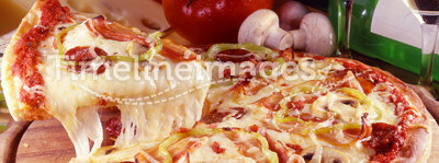 Pizza. Pizza with slice ready to serve