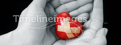Broken heart. Female hands with broken heart