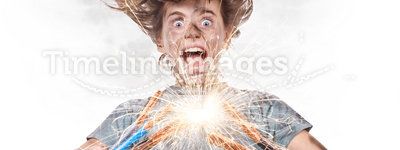 Sparks. Child with electric wires and sparks on white background