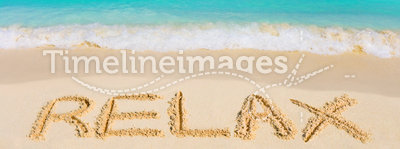 Word Relax on beach. Vacation concept background